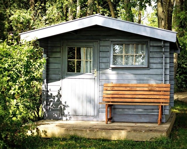 Grey Garden shed with a brown bench